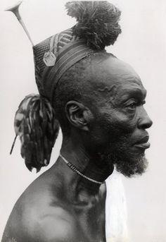 Africa | Mangbetu Warrior.  Poko region.  Congo .  ca. 1945 | ©Marcollin