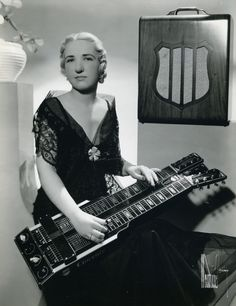 Letritia Kandle, electric guitar pioneer | with double neck console lap steel guitar and amp from the early 1940s http://www.vintageguitar.com/7684/7684/