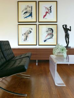 The body is celebrated in its many beautiful forms and angles in this space of the contemporary living room. The sketches are placed in gold and black frames, while the sculpture compliments the gallery wall.
