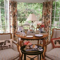 Charles Faudree's love of dogs is abundantly evident in the needlepointed spaniel pillows in this sunroom. - Traditional Home ®/ Design: Charles Faudree