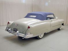 1950 White Cadillac Series 62 with a Purple Convertible Top