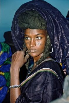 A WODAABE Women. The WODAABE People (sometimes called BORORO) are part of The FULANI 'Family'. They are Traditionally Nomadic Cattle Herders and Traders in the SAHEL travelling from SOUTHERN NIGER through NORTHERN NIGERIA, NORTH-EASTERN CAMEROON, SOUTH-WESTERN CHAD, and the WESTERN region of the CENTRAL AFRICAN REPUBLIC. <.