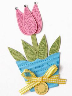 Design by Valerie Salmon Add ribbon, gems, or other embellishments to your stamped piecings for a fun look. Valerie's stamps form most of the decoration, but the subtle additions of a ribbon around the flowerpot and gems on the petals complete the adorable accents./