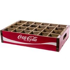 Our vintage-look Coca-Cola® Wooden Bottle Crate are more than just a blast from the past-they make a fun, practical home décor accent, too!