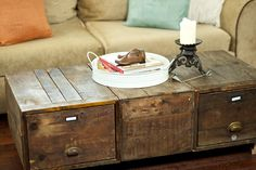 Coffee table made from old Rail Road file boxes... I am trying to convince my husband to make this one for our home! :) I love this!