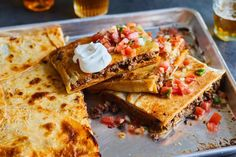 Sheet Pan Taco Bake This sheet pan taco bake, like the popular crunch wrap, is loaded with seasoned Baked Tacos Recipe, Taco Wraps, Crunch Wrap, Recipe Sheets, Sheet Pan Suppers, Taco Bake, Monterey Jack Cheese, Feeding A Crowd, Bon Appetit