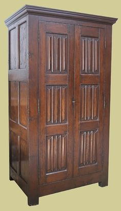 Oak wardrobe, with hand carved century style linenfold panelled doors and panelled sides, from our Chalvington handmade bespoke bedroom furniture range. Oak Bedroom Furniture, Home Furniture, Oak Wardrobe, Bedside Cabinet, Panel Doors, Tudor, Home Furnishings, Hand Carved, Medieval