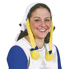 The Headscarf with Braids is a white scarf with an embroidered floral border and attached yellow yarn braids. The Oktoberfest headscarf with braids is made of cotton.