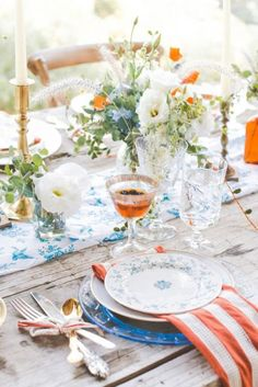 Beautiful table setting with blue and orange combination.