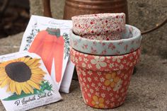 Decoupaged flower pots cost just a few dollars each to make and are great for gifting when paired with a plant or seed packets.