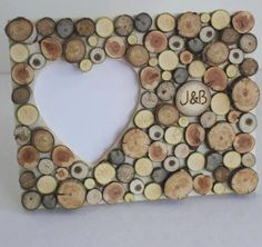 Personalized Photo Frame ---little wood slices (or buttons) arranged to fit and then wood burned to personalize. Wood Slice Crafts, Wooden Crafts, Wood Projects, Craft Projects, Personalized Photo Frames, Wine Cork Crafts, Wood Creations, Wood Slices, Nature Crafts