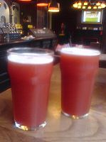 Now this is Fruli! It is a strawberry beer served on tap at bars in London. It has a pink frothy foam and it's simply delicious.