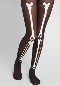 9873abf73a0 These black tights make your festive feelings crystal clear! Bright white  bones pattern the legs of this semi-sheer hosiery