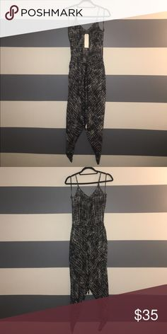 NWT Love & evoL Loose jumpsuit. Brand new loose jumpsuit with adjustable straps. Both legs have slits about knee high on the side. Drawstring at waste with two pockets to put hands in. Wear with blazer and heels for super chic fall outfit. Love & evoL  Pants Jumpsuits & Rompers
