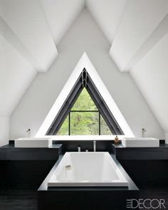 Under the Eaves: Great Attic Rooms.  This is the first image of an elegant bathroom in an attic or half story.