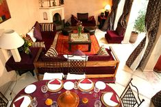I love the cohesiveness of this room, as well as that dark burgundy red, mmm