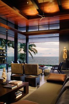 The Ocean House in Hawaii has a stunning view and a warm modern Asian design scheme. Create a relaxing seating area with taupe upholstered arm chairs, espresso wood loungers and coffee tables