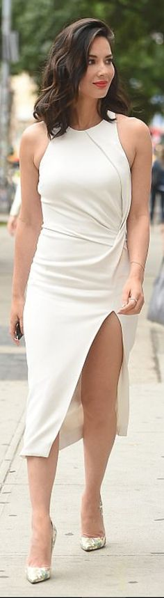 Who made Olivia Munn's white pleated dress and print pumps?