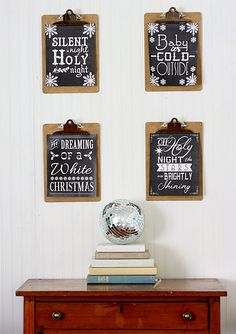 Christmas song printables. (Plus I am sort of living the clipboards as a way to display ever changing holiday printables...)