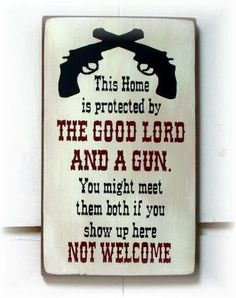 Welcome sign. Good lord and a gun. County thing.