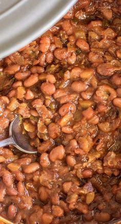 Sweet and Spicy BBQ Baked Beans ~ Says: The perfect balance of sweet from the the dark brown sugar wrapped around a nice kick from the jalapeño and cayenne pepper. Did I mention the secret ingredient? The crushed pineapple gives these beans a really nice tang