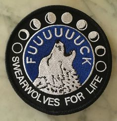 This big ol badass patch lets everyone know where your loyalties lie. Cuss at the moon! Swearwolves for life!  3.5 x 3.5 Embroidered twill patch with merrowed border Black, white, and dark royal blue  Designed and drawn by me