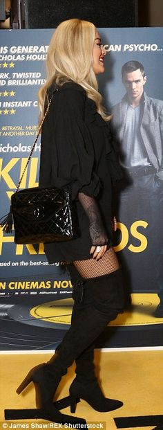 Strutting in: The star drew attention to her long legs with a pair of thigh-high boots teamed with a fish-net body stocking as she arrived at the screening