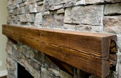 Awesome reclaimed wood mantel in this @Ironwood Homes home. #fireplaces #reclaimedwoodprojects #mantels