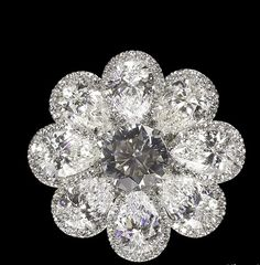 "David Morris ring diamond white gold oval shape pavé round cut high jewellery, is what they tellme. I think the ""petals"" are pear shape diamonds, but even so it's very lovely"