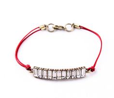 Crystal and red leather, looks great alone or paired with other bracelets.