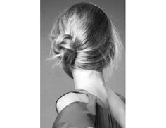 The Undone Side Bun Get the Look: Pick a side for your part, and then sweep your strands over just behind the opposite ear. Gather your hair into a relaxed ponytail in your hands. Once you're satisfied with the placement, twist the ponytail into a bun. Pin the sides all the way around, and lock it in place with generous coat of hairspray.