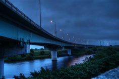 Shin Ebetsu Bridge in Ebetsu by Masao Minami