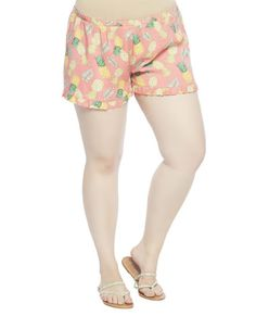 """Get a tropically sweet and super comfortable look in these adorable soft shorts featuring an all-over pineapple print with a ruffled hem and a smocked elastic waistband. Unlined.    Model is 5'9"""" and wears a size 1X.      12.5"""" From waist to hem / 2.5"""" Inseam / 32"""" Leg opening  100% Viscose  Imported  Machine Wash"""