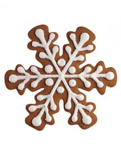 Because it just isn't Christmas without gingerbread! Martha likes to make different sizes of snowflakes, the ones pictured here are larger, but she makes smaller cookies as well. She pipes her cookies with royal icing and sprinkles them with fine sanding sugar.
