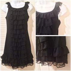 Adorable Xhilaration, black, ruffle, dress Adorable Xhilaration, black, ruffle, dress. Can be worn dressed up or casual. Size XS. 100% polyester. EUC. Xhilaration Dresses