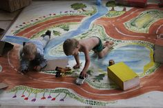 Polina Karpova's handmade map and cardboard houses via Kickcan & Conkers