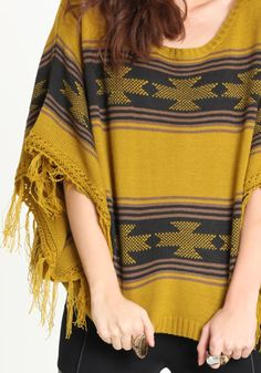 knit poncho in mustard.