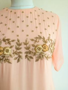 Get Set Pretty in this pastel Blush Shaded Handwork Tunic. The tunic features a . Embroidery Suits Punjabi, Embroidery On Kurtis, Hand Embroidery Dress, Kurti Embroidery Design, Embroidery Neck Designs, Embroidered Clothes, Embroidery Fashion, Embroidery Jewelry, Embroidery Fabric