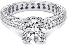 Tacori Channel-Set & Pave Diamond Engagement Ring  : This beautiful Tacori engagement ring # HT2326 features channel-set and pave-set round brilliant diamonds going around the band.  Currently priced with the diamonds going half-way around .50ct tw.  Select the diamond option below to price the ring with the diamonds going all the way around the band as pictured 1.02ct tw.