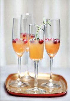 Sparkling Pear & Cranberry Cocktail: Put cranberries in a small bowl; add two tbs of warm water. Soak until cool. Drain, pat dry & refrigerate until serving. Divide pear nectar among 8 tall champagne glasses. Add cranberries and then pour champagne into glasses. Garnish with a rosemary sprig.