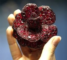 Ruby and diamond camellia flower brooch, designed by Paris-based American jeweler Joel Arthur Rosenthal, known as JAR