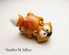 "A ""Friendly Fox"" original design by Heather Sellers.  The little guy is headed to Beads of Courage in September!"