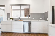 White matte Legato cabinets, custom designed to fit flush underneath the benchtop.
