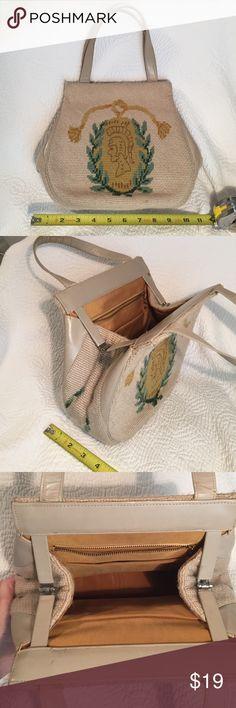 Vintage Needlepoint Trojan Purse Vintage handbag. Needlepointed beige, gold, and green with Trojan emblem on front & back. Leather straps. 3 interior pockets (2 open, 1 zipper). Gold harvest yellow satin interior. Vintage Bags Shoulder Bags