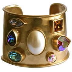 1980's YVES SAINT LAURENT heavy hammered gilt cuff with colorful faceted stones | From a unique collection of vintage cuff bracelets at http://www.1stdibs.com/jewelry/bracelets/cuff-bracelets/