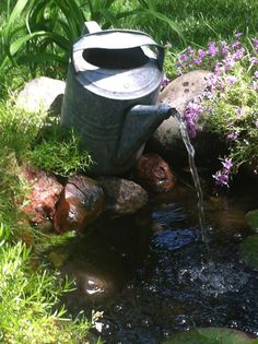 VIntage watering can fountain