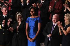Michelle Obama Cocktail Dress - Michelle Obama was a standout in an iridescent blue cocktail dress at the State of the Union Address.