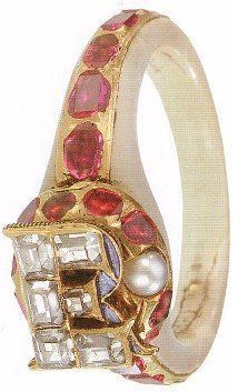 """""""ER RING"""" The ring was removed from Elizabeth I's finger after her death on March 24th 1603. It is mother-of-pearl, the band set with rubies. The 'E' has diamonds set over a blue enamel 'R'. A pearl is also clearly visible. This ring's stunning façade hides a secret – the head is hinged and within it lie two miniature enamel portraits, one of Elizabeth c. 1575 and one of an unnamed woman wearing a costume of Henry VIII's reign. It is thought that she is Anne Boleyn, Elizabeth's mother."""