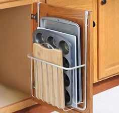 """Over-Door Organizer @ Harriet Carter Over-cabinet door organizer is the ideal storage solution for odd-sized kitchen items. Cutting boards, serving trays, baking sheets, cookie tins and more all find the perfect home in this handy storage rack. Say goodbye to cluttered cabinets and countertops—just hang rack over the inside of any cabinet door to hold items up to 18"""" H and 12"""" W. Stainless steel with a satin nickel finish. 20"""" H x 13-1/2"""" W x 4"""" D"""