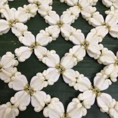Thai floral traditional garland การร้อยตาข่ายดอกรัก